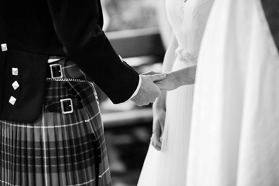 groom taking brides hand at church at a thames rowing club wedding, a handmade wedding, scottish wedding photographer © Fiona Kelly Photography