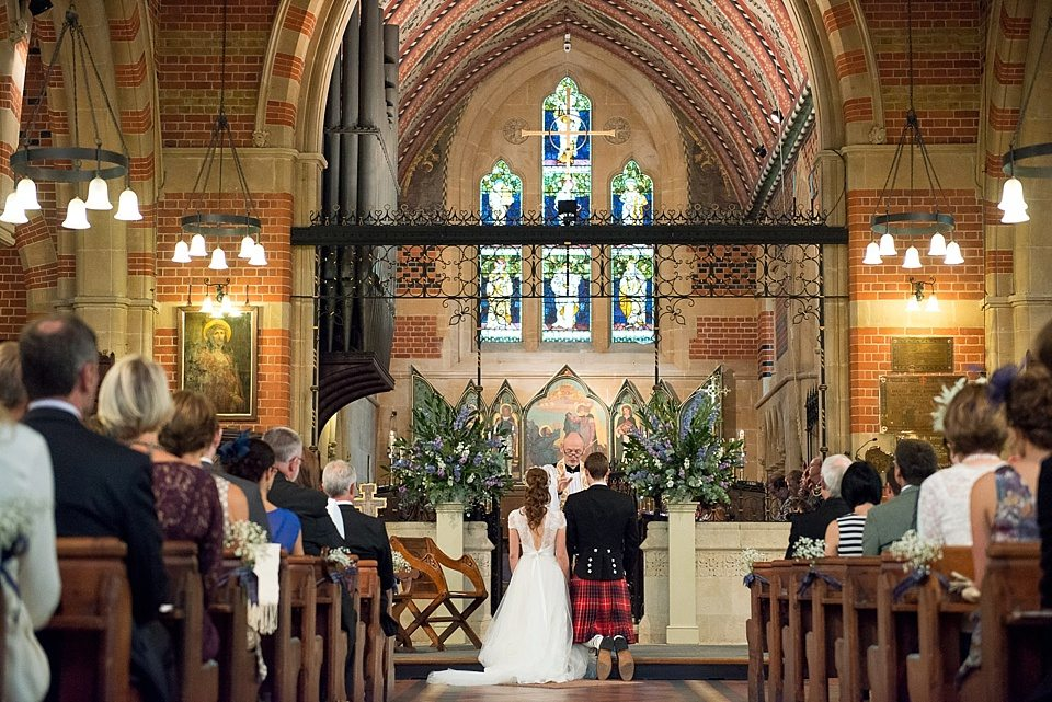 bride and groom kneeling at alter in church at a thames rowing club wedding, a handmade wedding, scottish wedding photographer © Fiona Kelly Photography