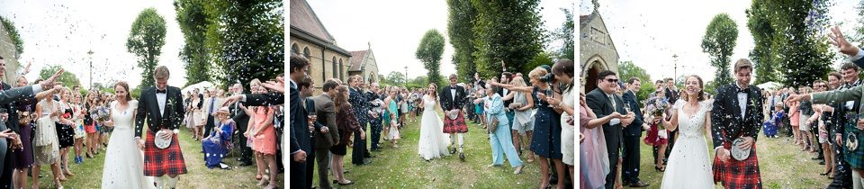 bride and groom walking through guests throwing confetti outside at a thames rowing club wedding, a handmade wedding, scottish wedding photographer © Fiona Kelly Photography