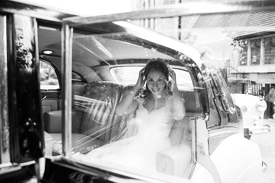 bride in vintage car holding family heirloom floral head band at a thames rowing club wedding, a handmade wedding, scottish wedding photographer © Fiona Kelly Photography
