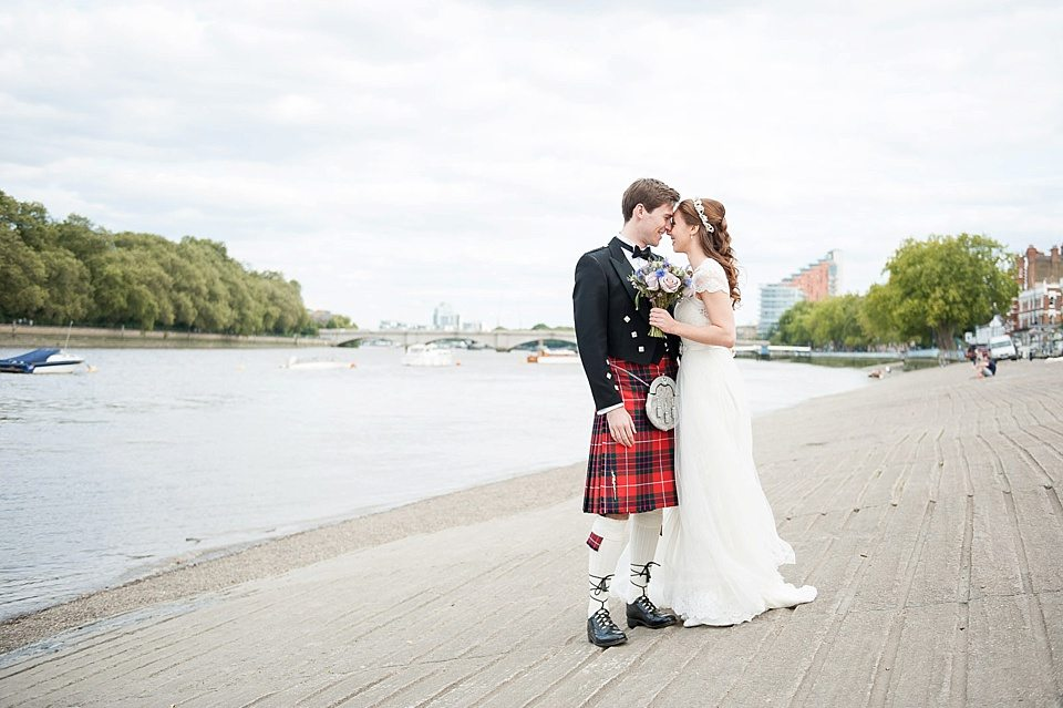bride and groom outside on the river bank of the thames at a rowing club wedding, a handmade wedding, scottish wedding photographer © Fiona Kelly Photography