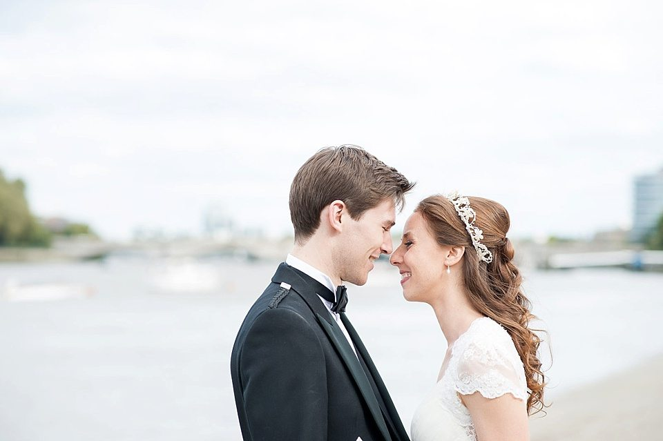 bride and groom smiling at a thames rowing club wedding, a handmade wedding, scottish wedding photographer © Fiona Kelly Photography