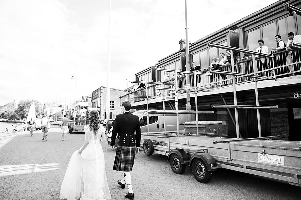 black and white shot of bride and groom at a thames rowing club wedding, a handmade wedding, scottish wedding photographer © Fiona Kelly Photography