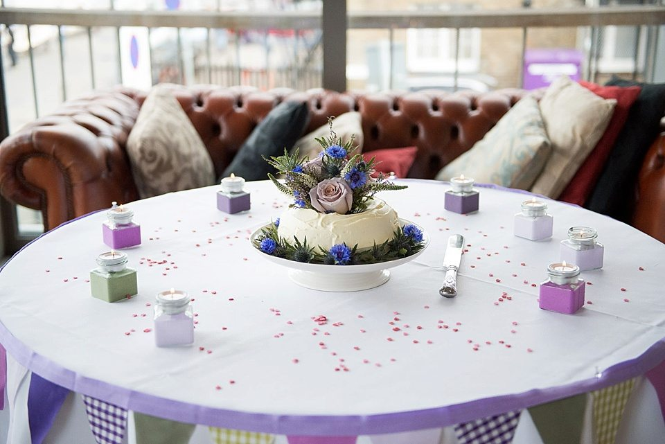 cake by the brides mum topped with rose and thistle decoration at a thames rowing club wedding, a handmade wedding, scottish wedding photographer © Fiona Kelly Photography