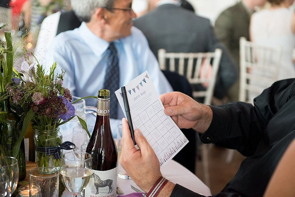 guest with speech bingo at a thames rowing club wedding, a handmade wedding, scottish wedding photographer © Fiona Kelly Photography