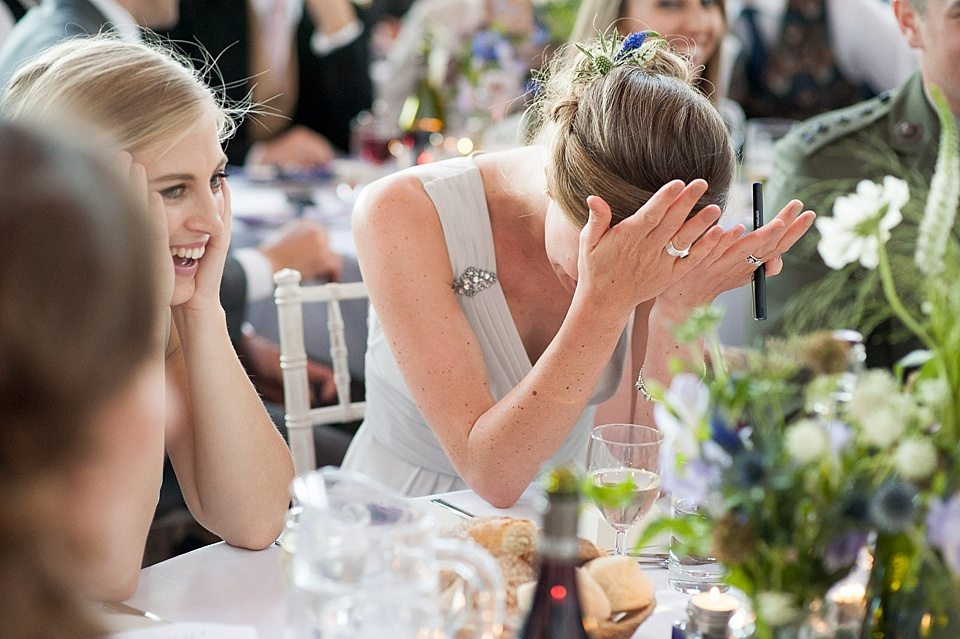 bridesmaids laughing in disbelief at the speeches at a thames rowing club wedding, a handmade wedding, scottish wedding photographer © Fiona Kelly Photography