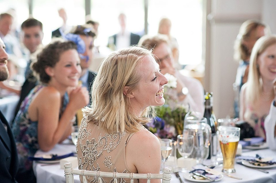 guests laughing at the speeches at a thames rowing club wedding, a handmade wedding, scottish wedding photographer © Fiona Kelly Photography