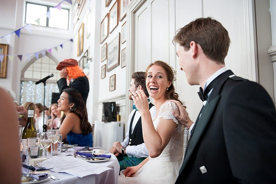 bride and groom laughing at father of the bride's speech at a thames rowing club wedding, a handmade wedding, scottish wedding photographer © Fiona Kelly Photography
