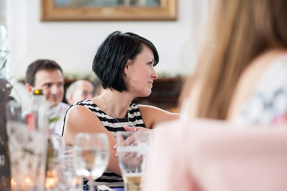guests listening to the grooms speech at a thames rowing club wedding, a handmade wedding, scottish wedding photographer © Fiona Kelly Photography
