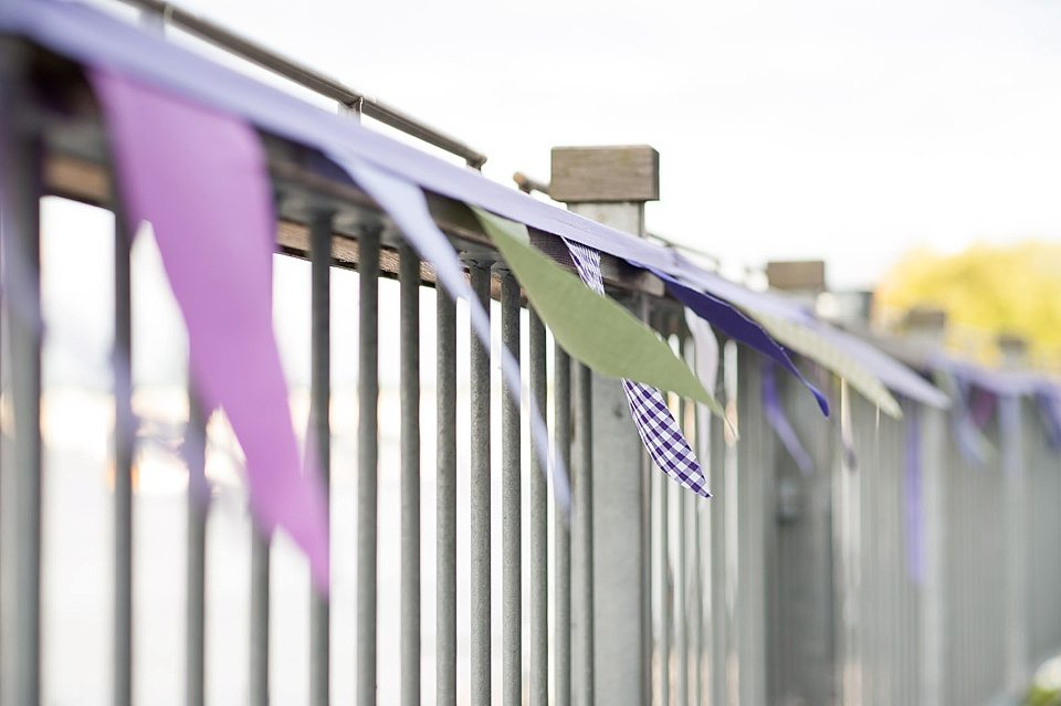 DIY bunting on silver gate at a thames rowing club wedding, a handmade wedding, scottish wedding photographer © Fiona Kelly Photography