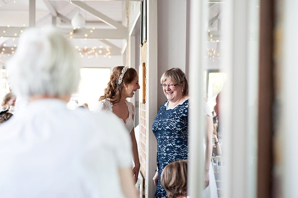 bride chatting to guest at a thames rowing club wedding, a handmade wedding, scottish wedding photographer © Fiona Kelly Photography