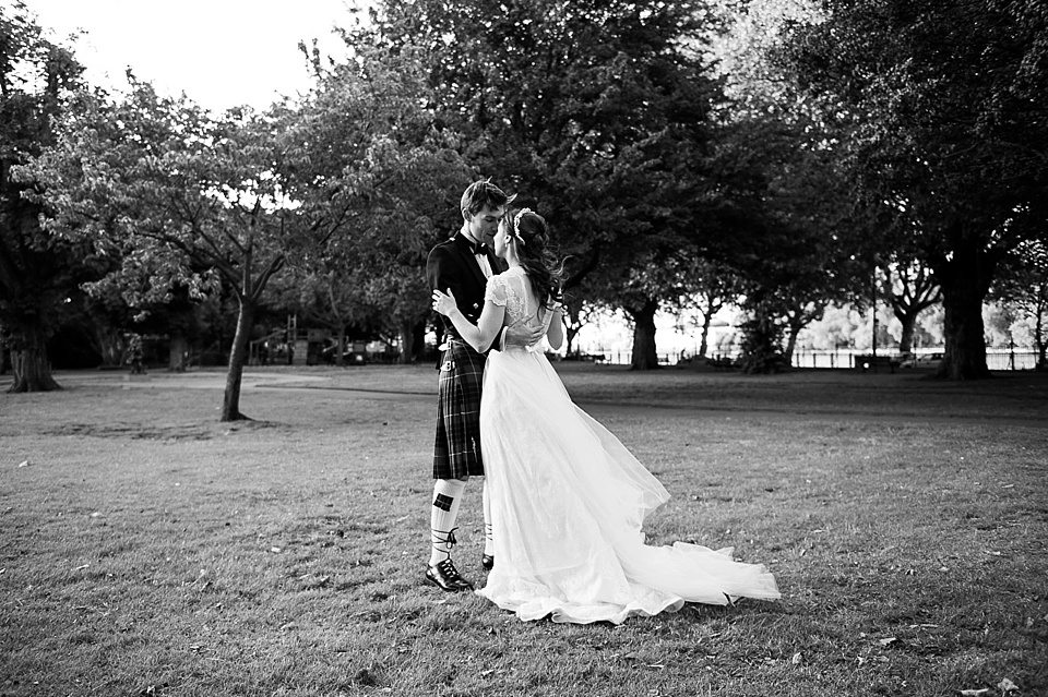 black and white shot of bride and groom embracing at a thames rowing club wedding, a handmade wedding, scottish wedding photographer © Fiona Kelly Photography