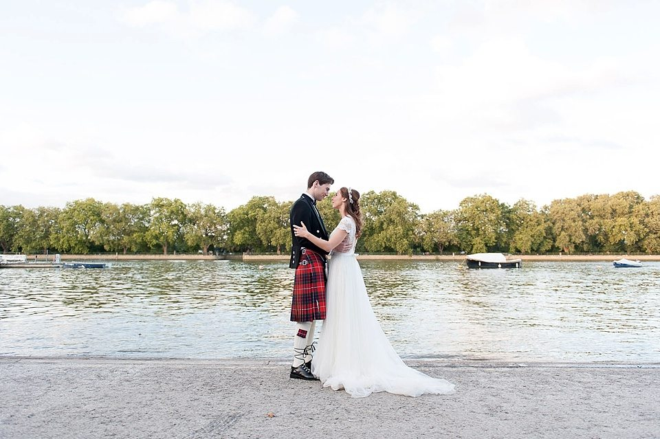 bride and groom on the river bank of the thames at a rowing club wedding, a handmade wedding, scottish wedding photographer © Fiona Kelly Photography