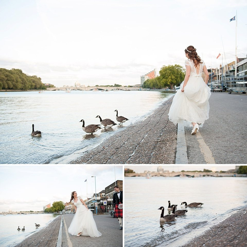 canadian geese waddle in the river whilst bride watches at a thames rowing club wedding, a handmade wedding, scottish wedding photographer © Fiona Kelly Photography