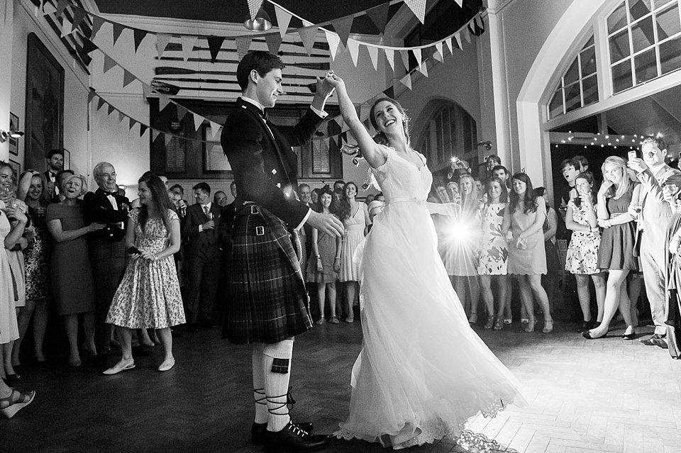 groom twirling bride around for their first dance and guests watch at a thames rowing club wedding, a handmade wedding, scottish wedding photographer © Fiona Kelly Photography