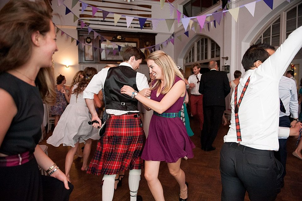 the groom scottish dancing with guests at a thames rowing club wedding, a handmade wedding, scottish wedding photographer © Fiona Kelly Photography