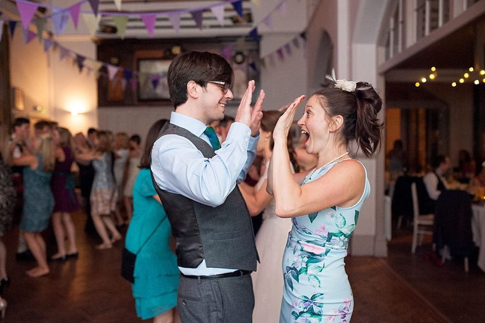couple clapping hands during scottish dancing at a thames rowing club wedding, a handmade wedding, scottish wedding photographer © Fiona Kelly Photography