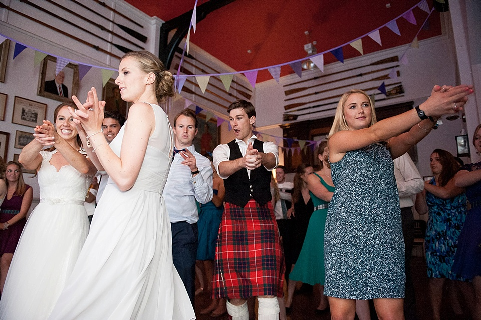 bride, bridesmaid, groom and guests dancing at a thames rowing club wedding, a handmade wedding, scottish wedding photographer © Fiona Kelly Photography