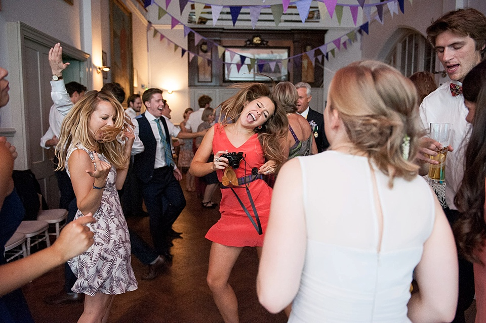 girls shaking heads on the dance floor at a thames rowing club wedding, a handmade wedding, scottish wedding photographer © Fiona Kelly Photography