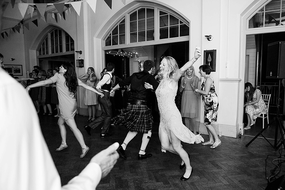 guests scottish dancing at a thames rowing club wedding, a handmade wedding, scottish wedding photographer © Fiona Kelly Photography