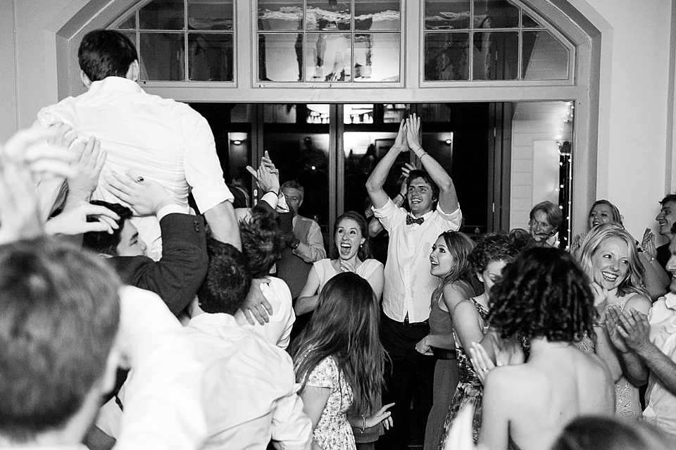 groom being lifted in air on the dance floor at a thames rowing club wedding, a handmade wedding, scottish wedding photographer © Fiona Kelly Photography
