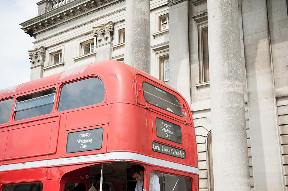 london-red-bus-arrives-at-moor-park-mansion-elegant-summer-wedding-photography©-Fiona-Kelly-Hertfordshire-wedding-photographer