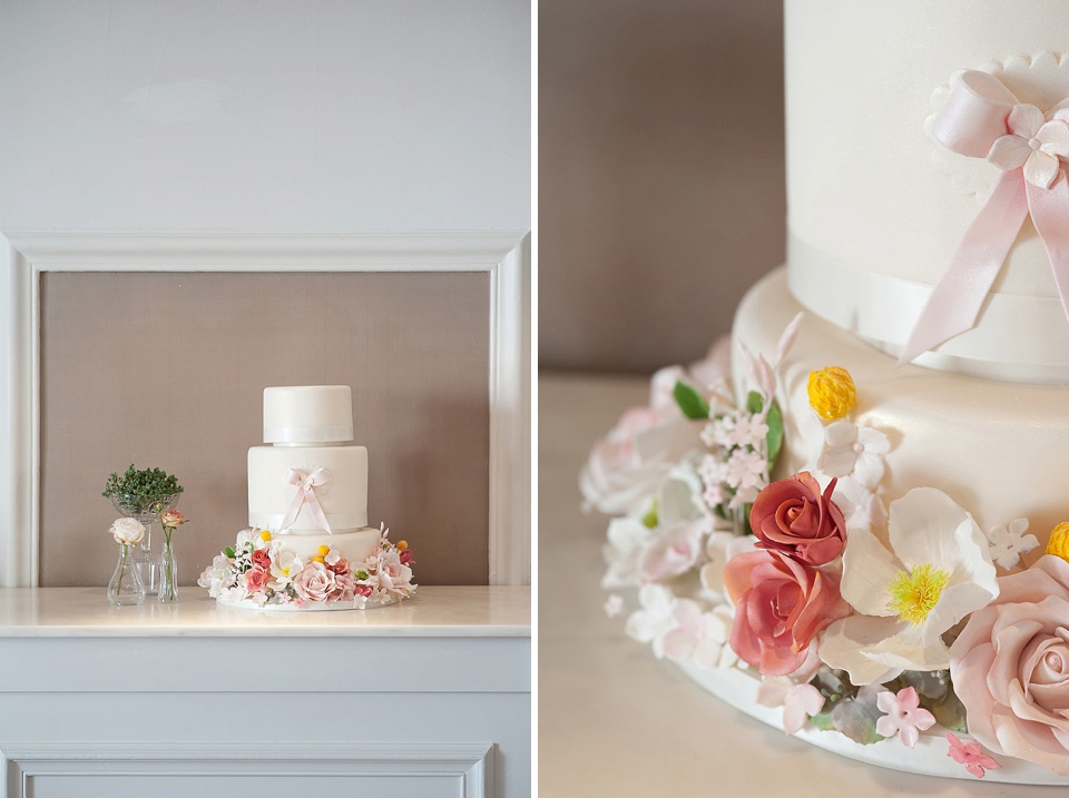 Wedding cake decorated with flowers by Krishanthi at The George in Rye - fine art photography © Fiona Kelly Photography
