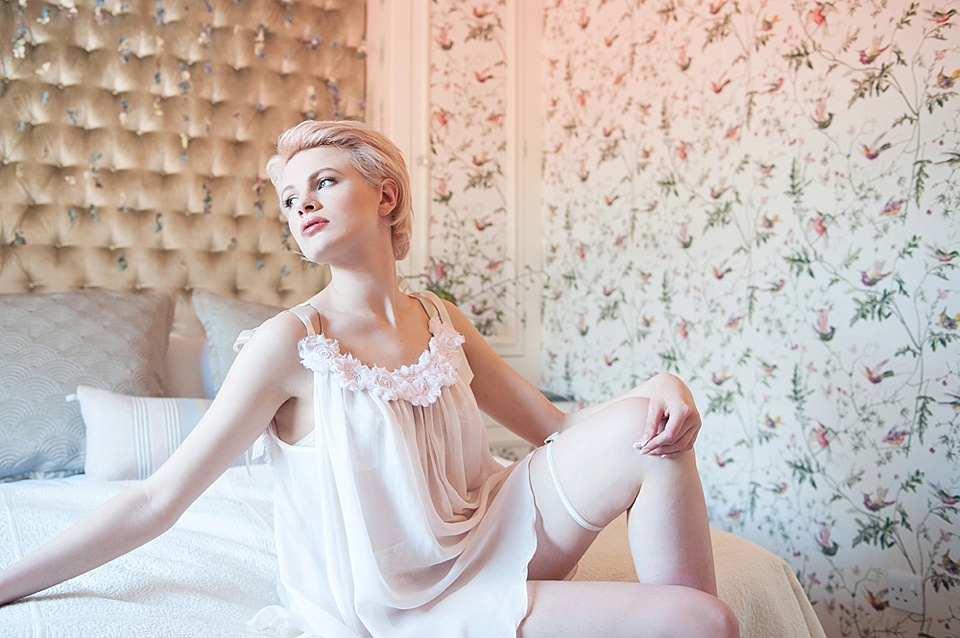 Feminine bridal boudoir shoot - Chloe-Jasmine Whichello in Ell & Cee lingerie and stockings at The George in Rye Kent fine art photography © Fiona Kelly Photography