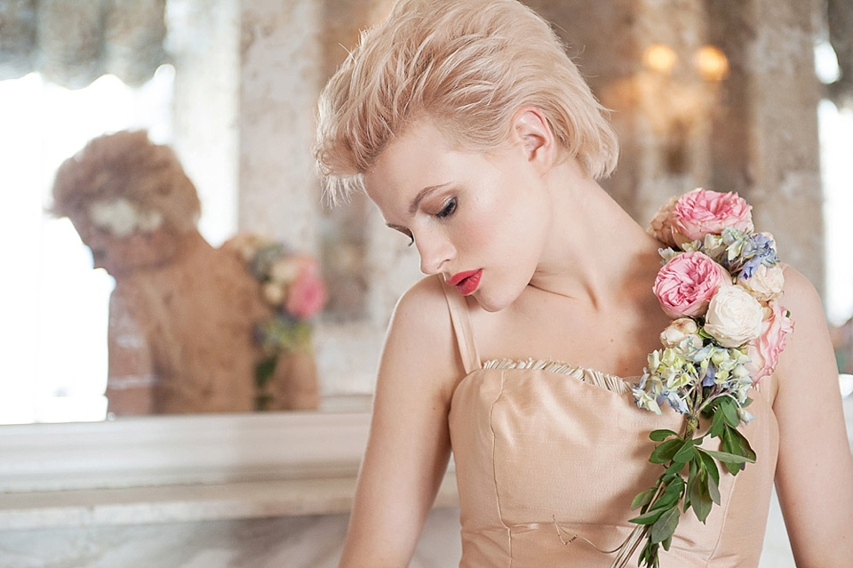 Short blonde hair and peach wedding dress by Faith Caton-Barber, wedding flowers by Indeco Flowers at The George in Rye Kent wedding boudoir photographer © Fiona Kelly Photography