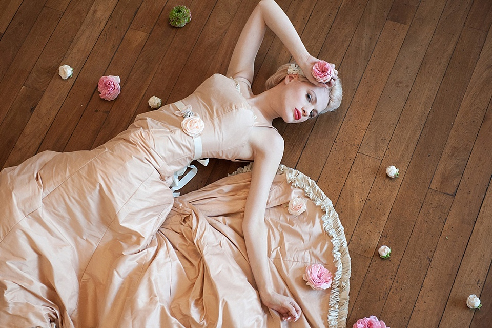 Peach wedding dress by Faith Caton-Barber, lying on the ball room floor, flowers by Indeco Flowers, styled by BLoved at The George in Rye Kent creative fine art photography © Fiona Kelly Photography