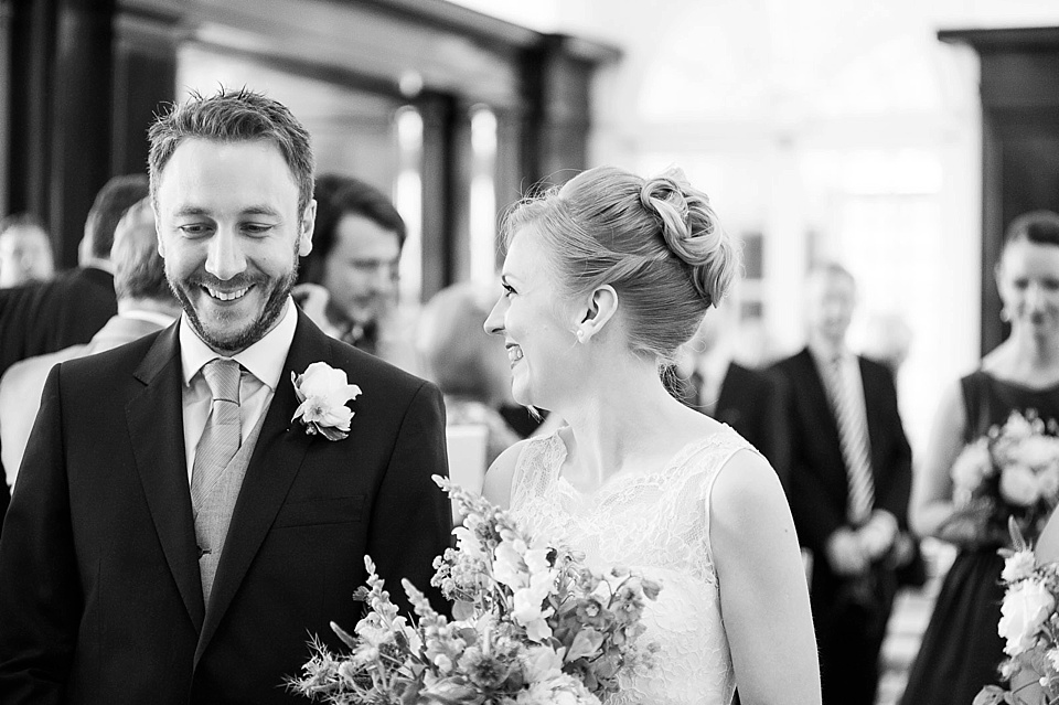 Bride and groom smiling in wedding ceremony - natural wedding photography by Fiona Kelly