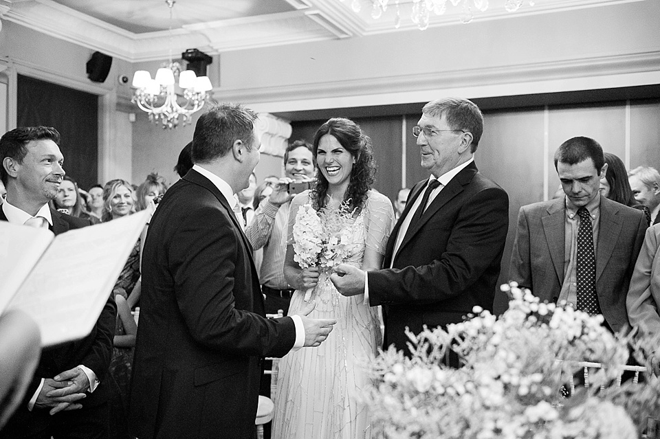 Bride giggling with father and groom - natural wedding photography by Fiona Kelly