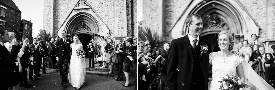 Black and white photo of bride and groom exiting the church - natural wedding photography by Fiona Kelly London