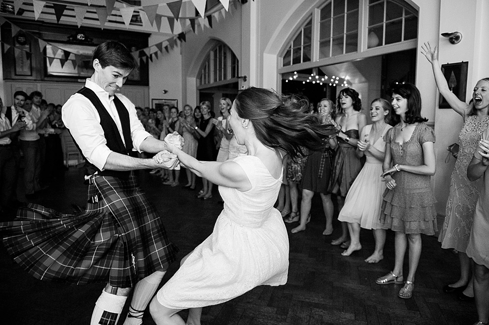 Capturing your wedding story - Bride in short dress dances with groom in kilt to ceilidh - The tradition of the wedding veil and white wedding dress - natural wedding photographer - Fiona Kelly