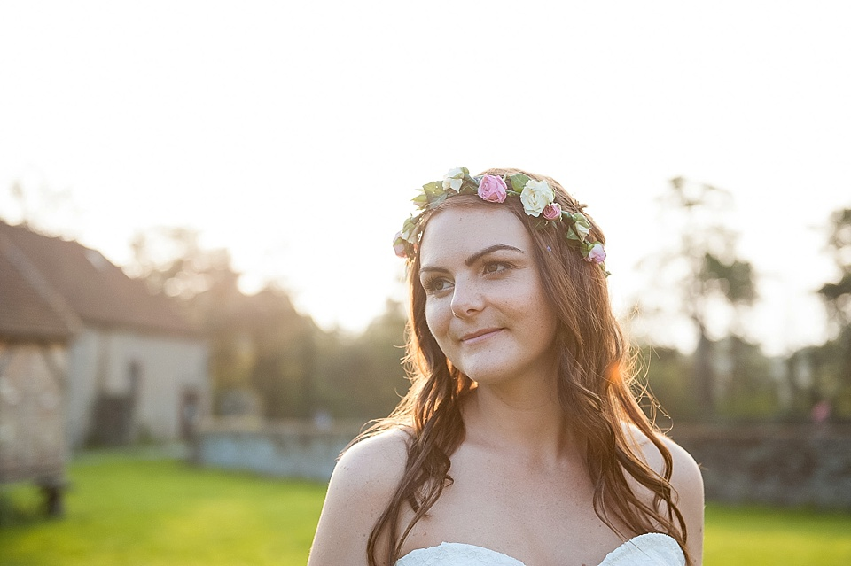 Bride with flower crown at sunset - The tradition of the wedding veil and white wedding dress - natural wedding photographer - Fiona Kelly