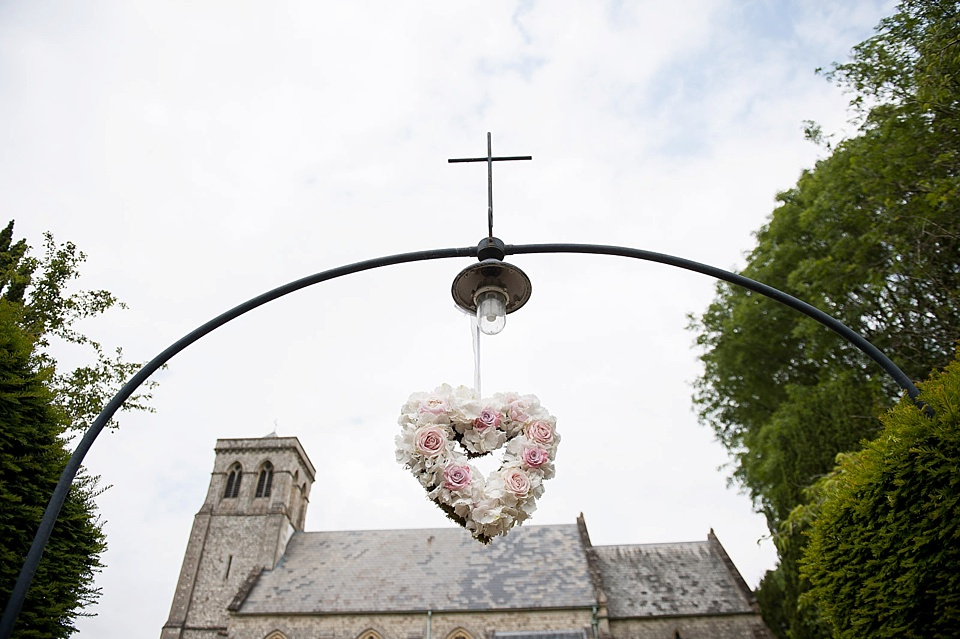 floral heart hanging over church entrance_0021