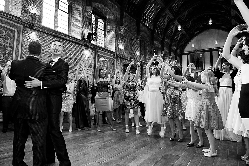 gay wedding first dance with all guests joining in