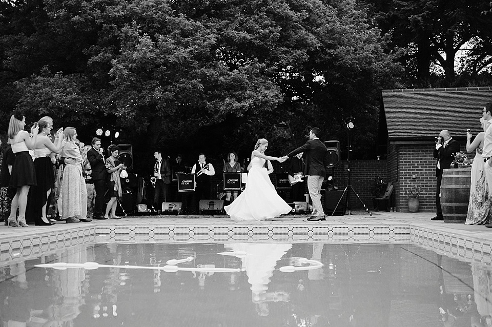 wedding first dance by swimming pool