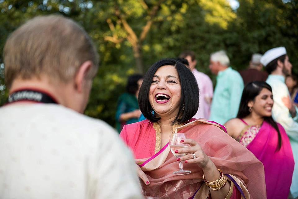 Glamorous woman in red sari laughing