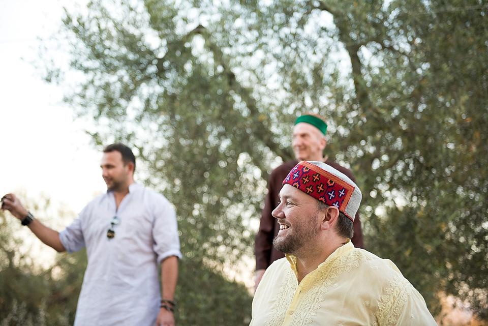 Men smiling at Indian wedding in Tuscany