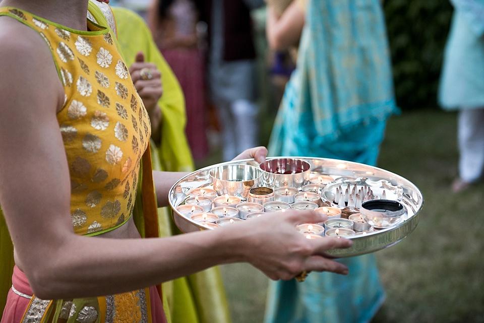 sainth - Indian tray full of candles at wedding
