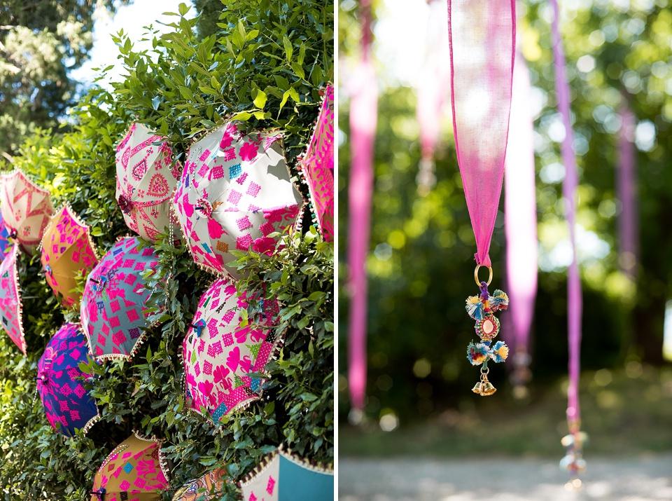 Pink parasols and ribbons decorate Tuscany wedding