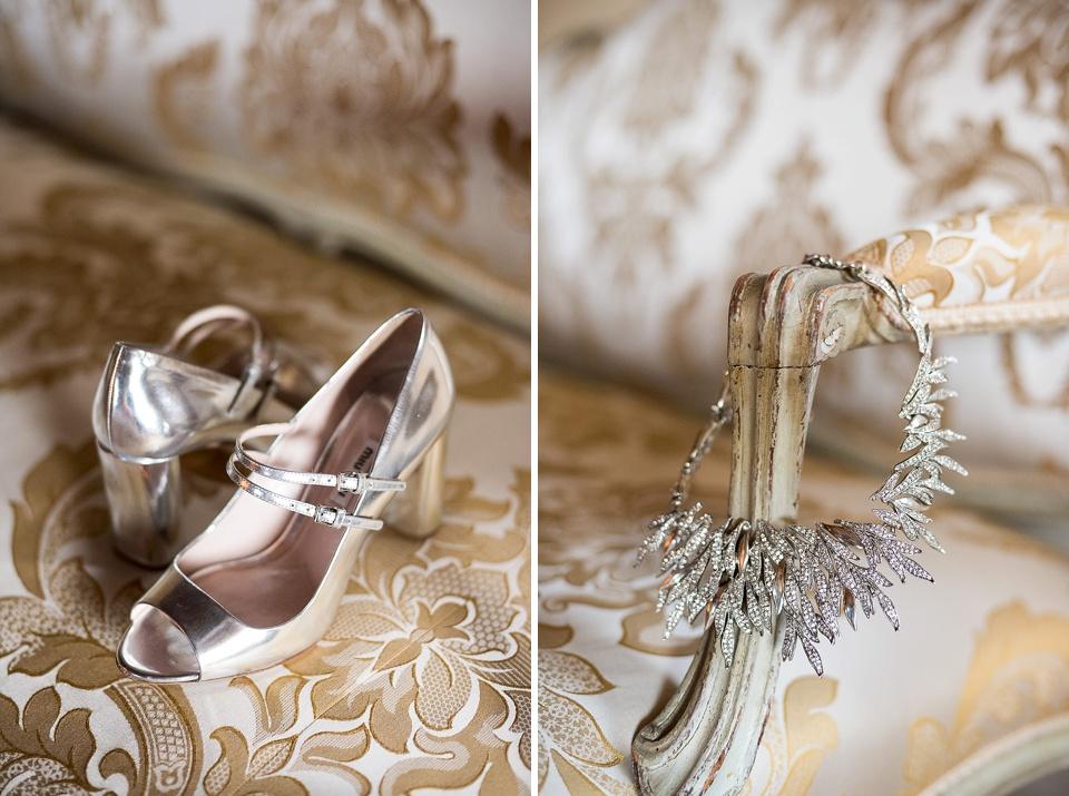 Silver wedding shoes and sparkly Oscar de la Renta necklace