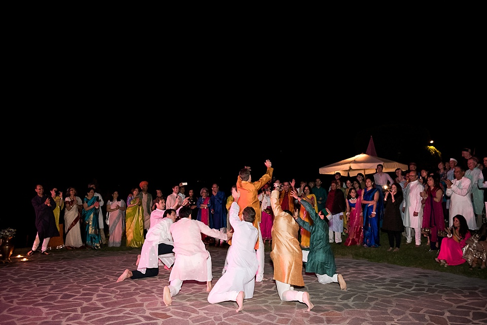 Groom and friends Bhangra dancing at Tuscany wedding