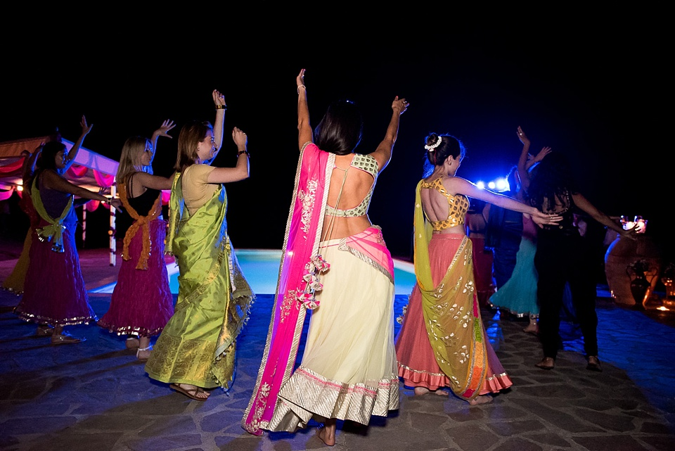 Indian bride and friends Bhangra dancing