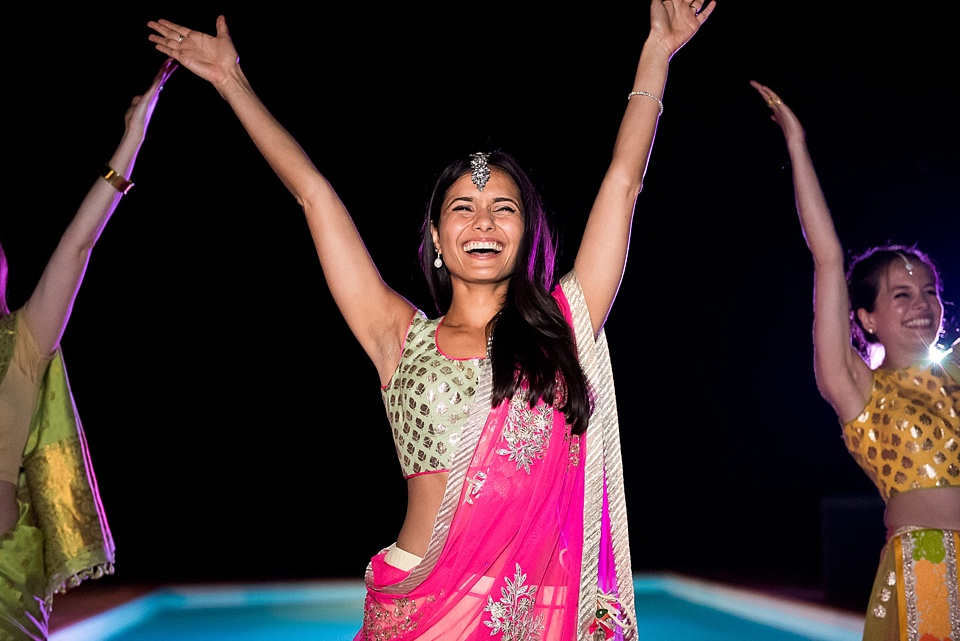 Beautiful Indian bride in pink sari Bhangra dancing