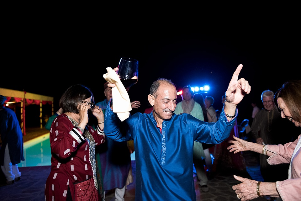 Father of the bride dancing in blue salwar kameez
