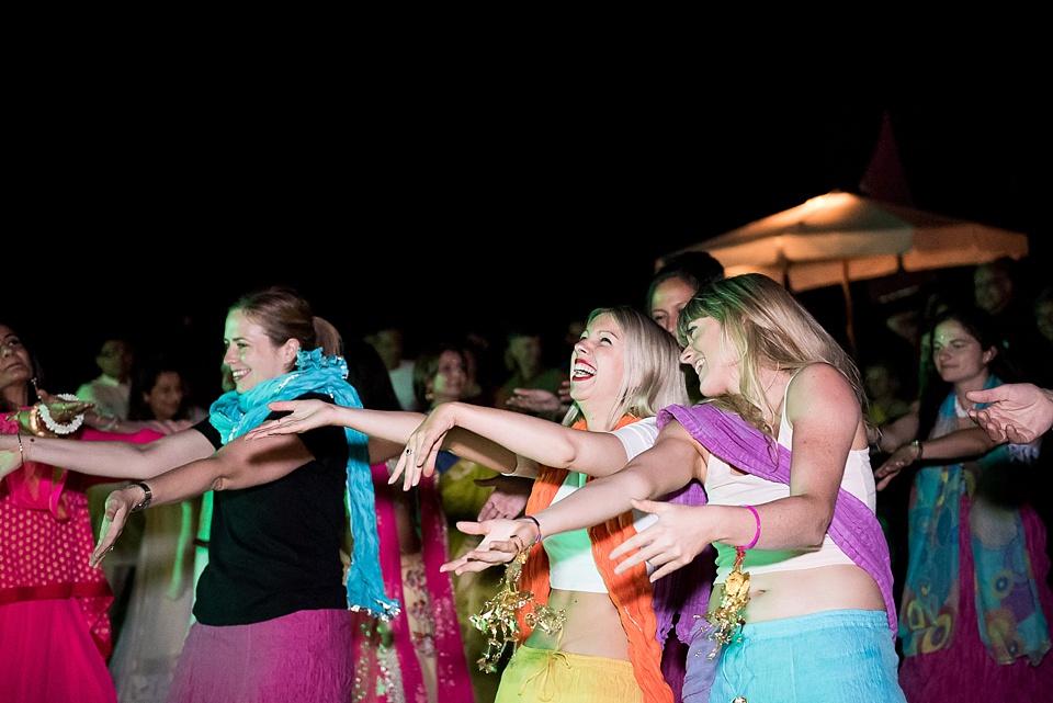 Women dancing in saris, laughing