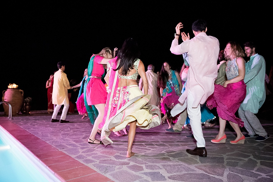 Colourful, lively dance floor at wedding in Tuscany