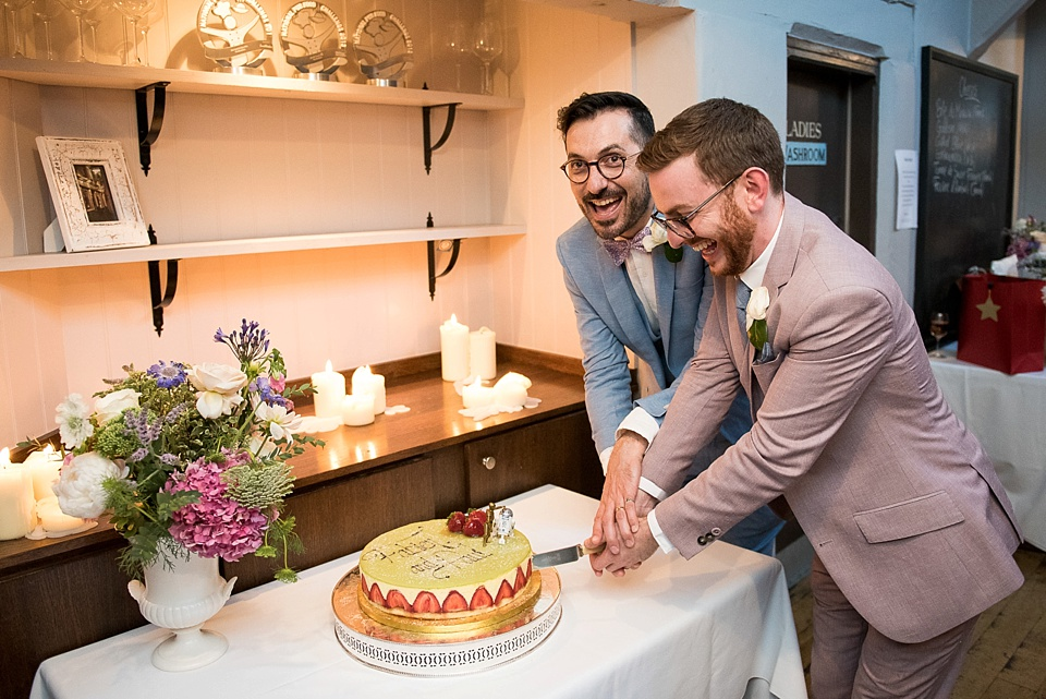 169 Two grooms cutting the cake London